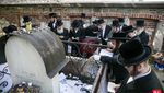 "Hundreds Davening At the Zion of the Bal Tosfos Yom Tov Zy""u in Krakow, Poland on his Yurtzeit"